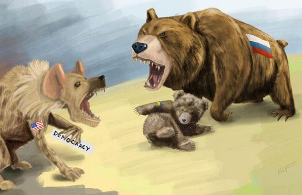Медведь охраняет медвеженка